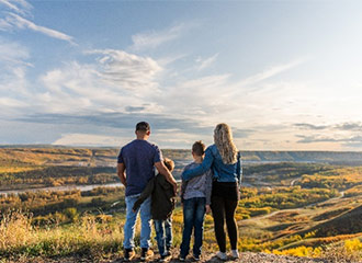 Family looking over a view point in Fort St. John