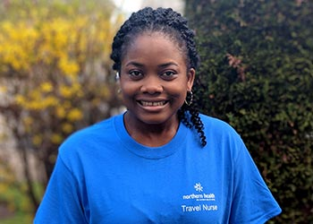 Woman wearing a Northern Health Travel Nurse T-Shirt